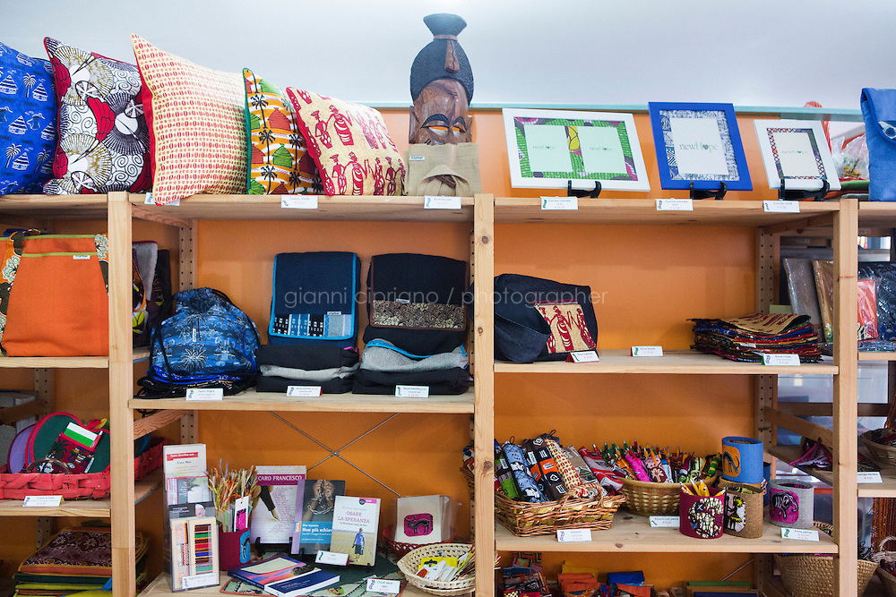 CASERTA, ITALY - 25 FEBRUARY 2015: Handmade products are displayed inside the Bottega Fantasia (Fantasy store), next to the New Hope tailor's shop in Caserta, Italy, where ex-sex workers helped by nuns make make products with mainly  African fabrics, on February 25th 2015.<br /> <br /> New Hope is an ethnic tailor's shop that makes a variety of colourful products working mainly african fabrics. The New Hope social cooperative, founded in 2014, promotes a training workshop for your immigrant women, many of which have children, that want to integrate in Italian society.