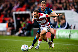 Alfie Kilgour of Bristol Rovers takes on Jon Taylor of Doncaster Rovers - Mandatory by-line: Robbie Stephenson/JMP - 19/10/2019 - FOOTBALL - The Keepmoat Stadium - Doncaster, England - Doncaster Rovers v Bristol Rovers - Sky Bet League One