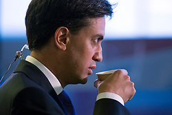© London News Pictures. 25/09/2013 . Brighton, UK. Labour Party Leader ED MILIBAND drinking a cup of coffee while waiting to give an interview to television at The Brighton Centre the morning after delivering his Keynote speech at the Labour Party Conference. Photo credit : Ben Cawthra/LNP