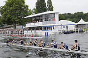 Henley, Great Britain.  Henley Royal Regatta. Upper Yarra Rowing Club, Australia, AUS, exhausted, as they cross the Finish Line, ahead of Star Club, winning, the Thames Challenge Cup. River Thames,  Henley Reach.  Royal Regatta. River Thames Henley Reach. Sunday  14:56:31  03/07/2011  [Mandatory Credit/Intersport Images] . HRR