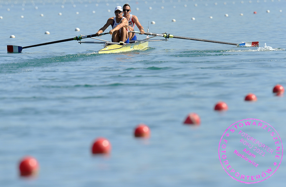 (L) MICHAEL MOLINA & (R) LIONEL JACQUIOT (BOTH FRANCE) COMPETE AT MEN'S PAIR HEAT DURING DAY 1 FISA ROWING WORLD CUP ON ESTANY LAKE IN BANYOLES, SPAIN...BANYOLES , SPAIN , MAY 29, 2009..( PHOTO BY ADAM NURKIEWICZ / MEDIASPORT )..PICTURE ALSO AVAIBLE IN RAW OR TIFF FORMAT ON SPECIAL REQUEST.