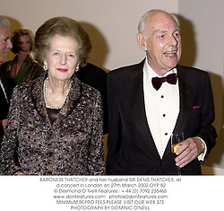 BARONESS THATCHER and her husband SIR DENIS THATCHER, at a concert in London on 27th March 2002.OYP 82