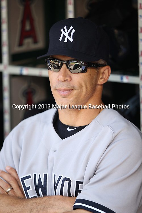 ANAHEIM, CA - JUNE 15:  Joe Girardi #28 of the New York Yankees looks on from the dugout during the game against the Los Angeles Angels of Anaheim on Saturday, June 15, 2013 at Angel Stadium in Anaheim, California. The Angels won the game 6-2. (Photo by Paul Spinelli/MLB Photos via Getty Images) *** Local Caption *** Joe Girardi