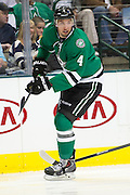 DALLAS, TX - OCTOBER 17:  Brenden Dillon #4 of the Dallas Stars looks on against the San Jose Sharks on October 17, 2013 at the American Airlines Center in Dallas, Texas.  (Photo by Cooper Neill/Getty Images) *** Local Caption *** Brenden Dillon