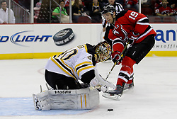 Apr 10; Newark, NJ, USA; Boston Bruins goalie Tuukka Rask (40) makes a save on a shot from New Jersey Devils center Travis Zajac (19) during the second period of their game at the Prudential Center.