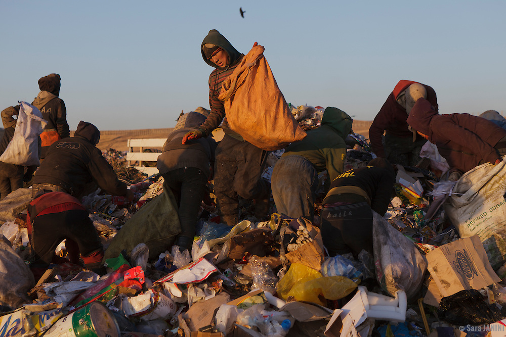 ULAN BATOR WASTE DUMP<br /> This huge open air waste dump in Ulan Bator, capital of Mongolia, with more than 1,5 million people is full of poor scavengers. Many of them are children searching into the junk looking for plastic bottles, aluminium cans, metal, anything to sell or burn.  Because of the freezing winters the amount can reach till 600 tonnes, double than in summer, just to heat the coal fires of the Yurts. <br /> The conditions and the contaminated air is unsustainable. The World Bank estimates that in low-income countries around the globe about 2% of the population make a living by selling salvaged materials.
