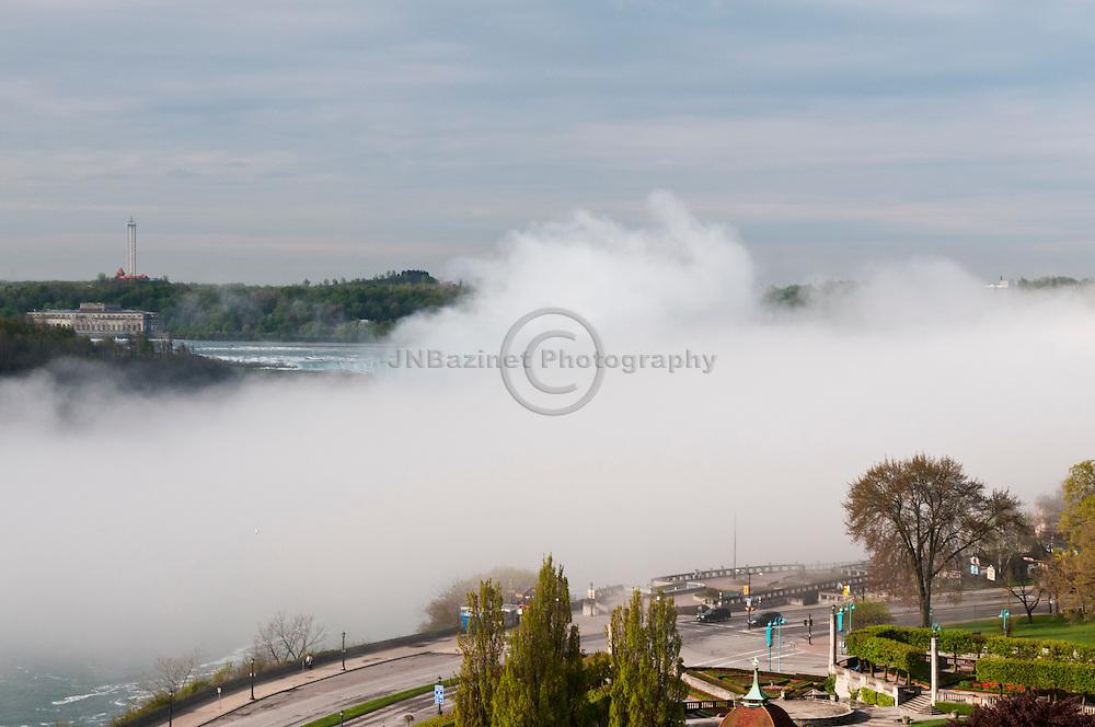 Thick, heavy fog fills Niagara River and conceals Horseshoe Falls - Niagara, Canada
