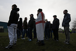 © Licensed to London News Pictures . 20/01/2018. Doncaster, UK. Far-right street protest movement , the English Defence League ( EDL ) , hold a demonstration , opposed by anti-fascists , including Unite Against Fascism ( UAF ) in a park in Hexthorpe in Doncaster . EDL supporters chanted anti-Roma slogans as they marched through the town . Photo credit: Joel Goodman/LNP