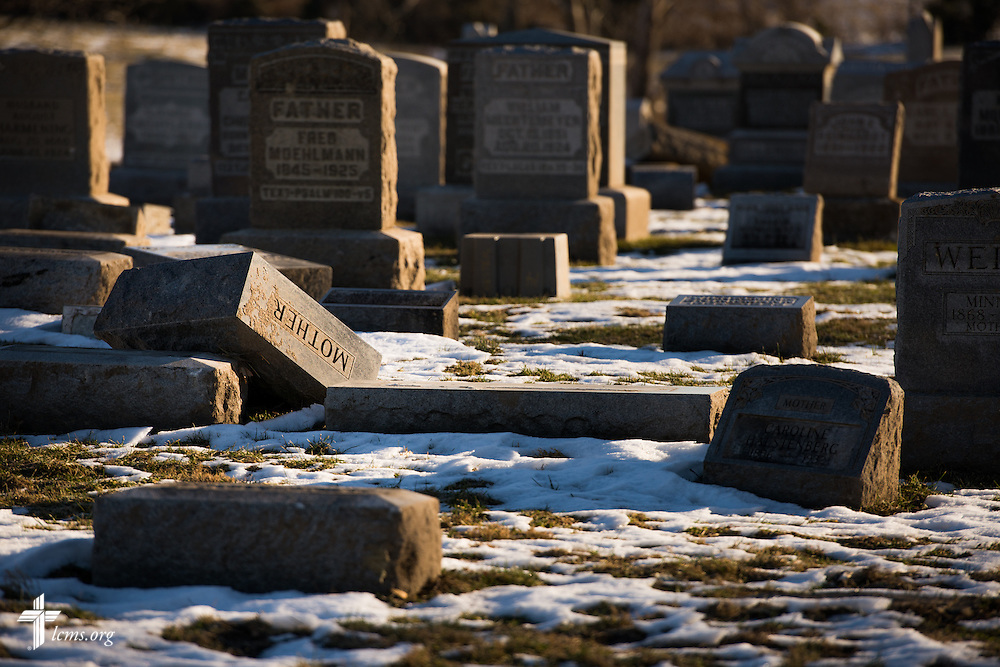 Broken cemetery markers litter the grounds next to Saint John Lutheran Church in New Minden, Ill., on Wednesday, Dec. 18, 2013. The tornado that damaged the church and surrounding homes in November was one among nearly two dozen that swept through the state, killing a total of seven. LCMS Communications/Erik M. Lunsford