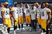 TAMPA, FL - JANUARY 27: A group of AFC Pittsburgh Steelers pose for a photo with a youngster from the local NFL YET (youth education town) center during Super Bowl XLIII Media Day at Raymond James Stadium on January 27, 2009 in Tampa, Florida. ©Paul Anthony Spinelli