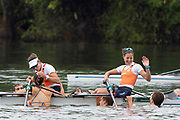 """Rio de Janeiro. BRAZIL. Gold Medalist NED LW2X. Bow. Ilse PAULIS, and Maaike<br /> HEAD, after winning the final, supporters swim out to greet and congratulate the double. 2016  2016 Olympic Rowing Regatta. Lagoa Stadium,<br /> Copacabana,  """"Olympic Summer Games""""<br /> Rodrigo de Freitas Lagoon, Lagoa. Local Time 10:40:10  Friday  12/08/2016 <br /> [Mandatory Credit; Peter SPURRIER/Intersport Images]"""