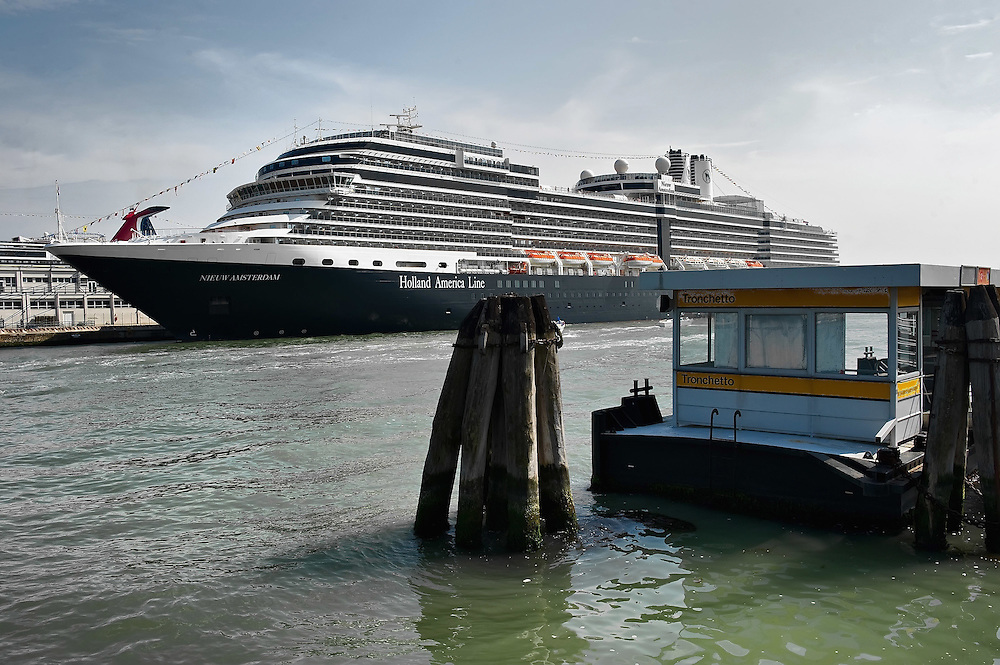 VENICE, ITALY - MAY 02:  Cruise ship Nieuw Amsterdam is seen at the dock of Venice Cruise Terminal on May 1, 2011 in Venice, Italy. Giant cruise ships passing through  St Mark Basin and Giudecca Canal are causing continue controversy for the possible damages to the lagoon and Venice building