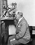 William Henry Bragg (1862-1942) English physicist.  Founder of  X-ray crystallography, he is shown here using an X-ray spectrometer. In 1915, with his son (William) Lawrence Bragg ( 1890-1871) he shared the Nobel prize for physics.