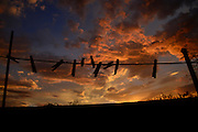 Clothes pins are silhouetted at sunset in Tucson, Arizona, USA.