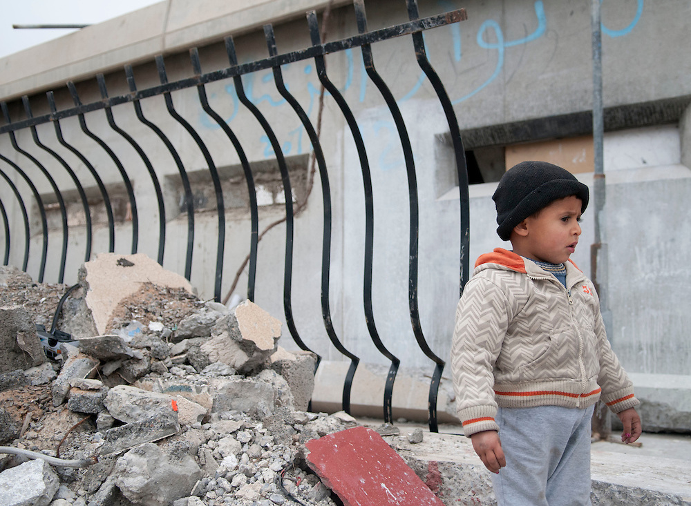 A young boy stands outside his families home in Bab Al-Azizia, Gaddafi's former compound in Tripoli. The home is a refurbished military bunker, one of the few not destroyed during NATO bombing.