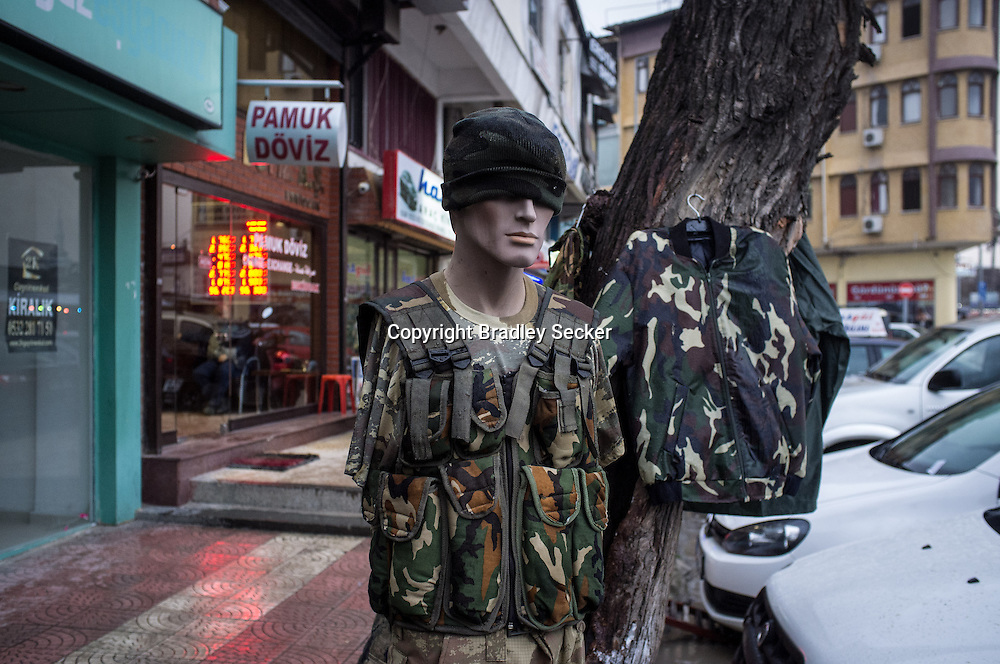 ANTAKYA, TURKEY. JANUARY 23. A mannequin dressed in military clothes, outside a army supply store close to the Turkish border with Syria. Bradley Secker for the Washington Post