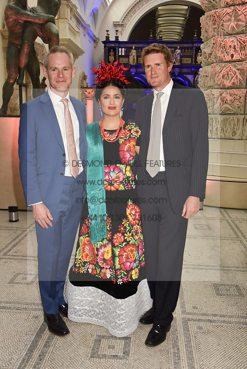 "Left to right, Craig McWilliam, Salma Hayek and Tristram Hunt at the opening of ""Frida Kahlo: Making Her Self Up"" Exhibition at the V&A Museum, London England. 13 June 2018."