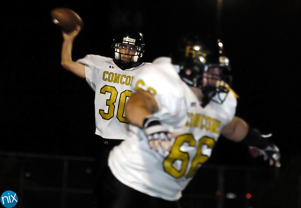 Concord quarterback #30 (NAME NOT ON ROSTER ... ASK PAUL) passes the ball against Sun Valley Friday night in Monroe.