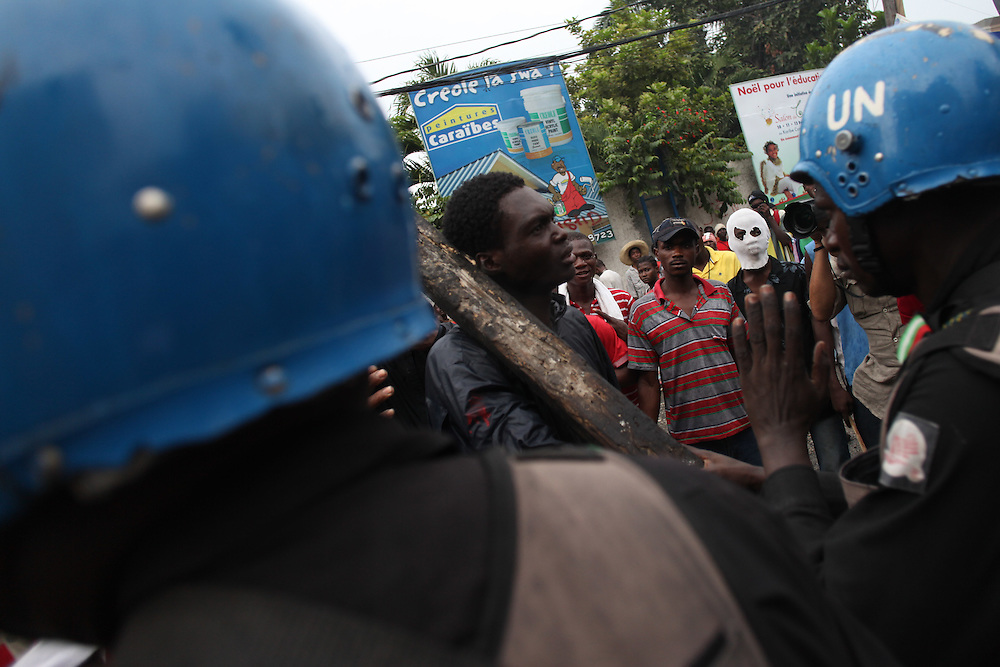 UN soldiers confront protestors as they try to approach the Provisional Electoral Council office. Protestors take to the streets for the second day in a row in response to Haiti's election results which were announced on Tuesday December 7th among allegations of fraud.