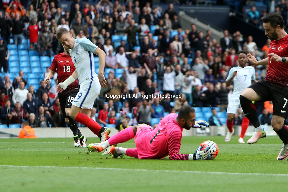 22.05.2016. Etihad Stadium, Manchester, England. International football friendly match, England versus Turkey. Turkey goalkeeper  Babacan saves at the feet of Jamie Vardy