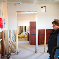 020314       Adron Gardner<br /> <br /> Roselyn John stands in an unfinished office for the the Chichiltah Chapter House in Chichiltah Monday. The chapter house shut down 5 years ago because of mold, asbestos and water issues and $600,000 is needed to build a new chapter house.