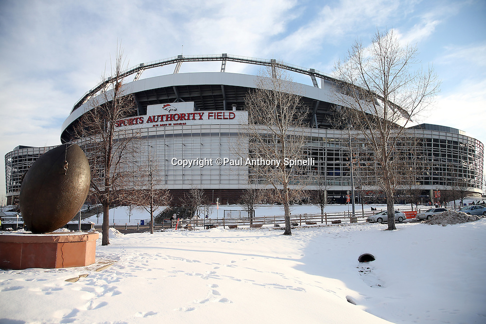 The Sports Authority Field at Mile High stadium stands tall in the background with snow covered grounds shown in the foreground in this wide angle, general view photograph taken before the Cincinnati Bengals 2015 NFL week 16 regular season football game against the Denver Broncos on Monday, Dec. 28, 2015 in Denver. (©Paul Anthony Spinelli)