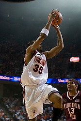 Virginia forward Adrian Joseph (30) shoots a three pointer over Virginia Tech forward Deron Washington (13).  The Virginia Cavaliers men's basketball team faced the Virginia Tech Hokies at the John Paul Jones Arena in Charlottesville, VA on January 16, 2008.
