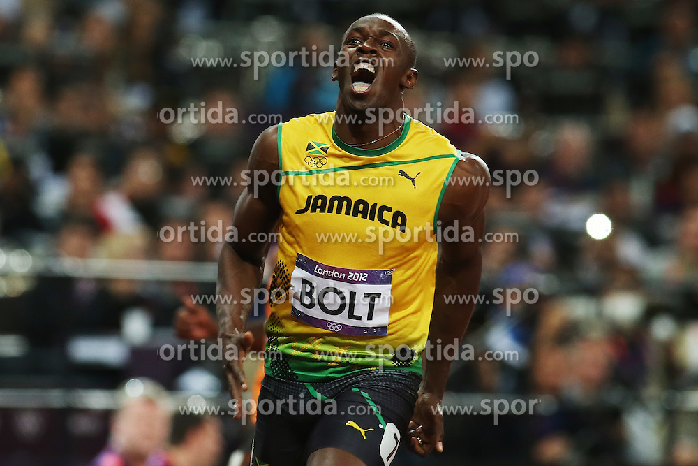 Olympics - London 2012 Olympic Games - 5/8/12.Athletics - Men's 100m Final - Jamaica's Usain Bolt celebrates after winning the race to get gold.© pixathlon