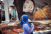 Painters on the Streets of Singapore<br /><br />A great new piece by artist Ernest Zacharevic on the streets of Singapore. The artist made several stops in Europe this year with his trademark photo-based murals showing up in Italy, Lithuania and Norway. Zacharevic says of his art:<br /><br />    Most of my work is photography based and site-specific, so I photograph my subjects and later choose angles for painting. Working with children allows more anonymity, I don't consider my artworks to be portraits of a specific person, rather a universal experience.<br />©Ernest Zacharevic/Exclusivepix