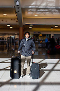 International student Carlos Donado poses for a portrait after a flight from Panama City, Panama in Hartsfield-Jackson Atlanta International Airport in Atlanta, Georgia January 6, 2009. Donado said his student form was checked this flight, which caused a little delay.