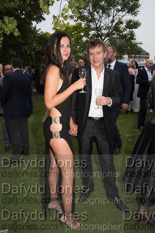 ADRIENN ALMASY; CARY MARTIN, 2016 SERPENTINE SUMMER FUNDRAISER PARTY CO-HOSTED BY TOMMY HILFIGER. Serpentine Pavilion, Designed by Bjarke Ingels (BIG), Kensington Gardens. London. 6 July 2016