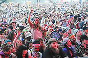 A young woman gets into the music during at The Other Stage during The Bonnaroo Music and Arts Festival