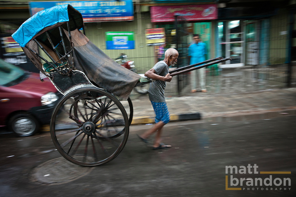 The old seem to dominate this profession. Leaving the younger to run the bicycle rickshaws.