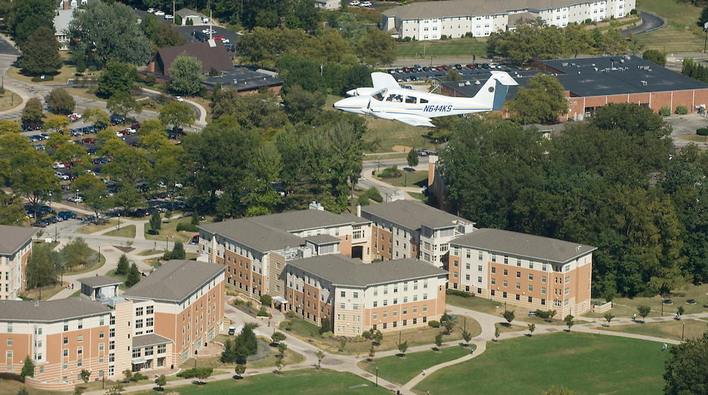 A Kent State owned airplne, the only twin engine plane the university owns, flies over part of campus.