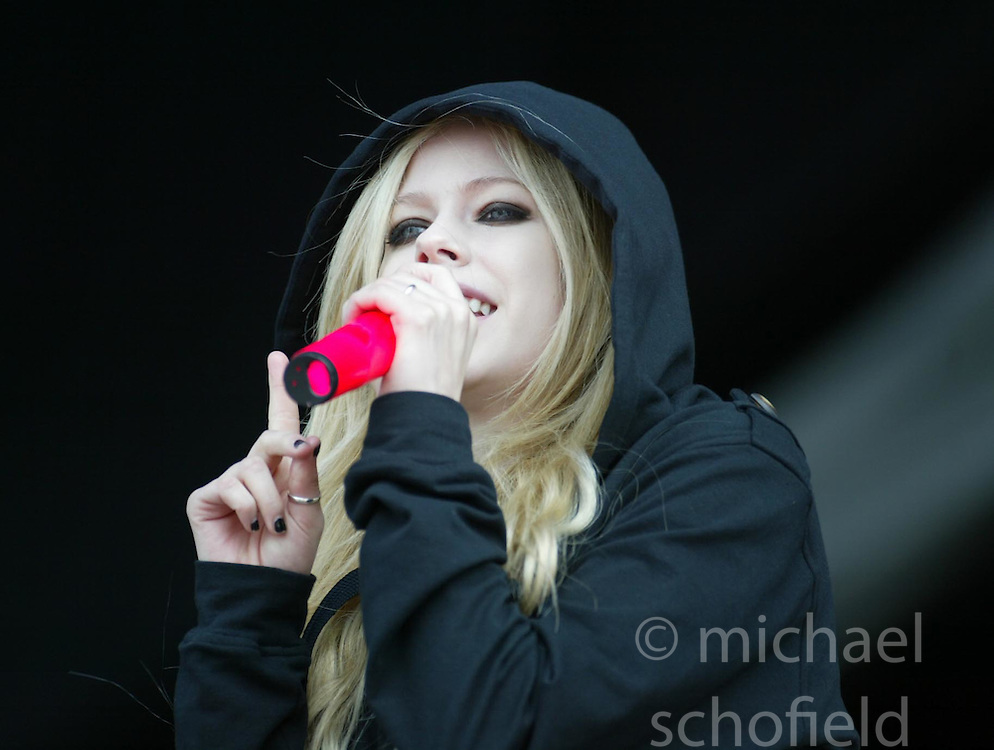 Avril Lavigne, the Canadian singer-songwriter, plays on the main stage at T in the Park, Sunday 8 July 2007..T in the Park festival took place on the 6th, 7th and 8 July 2007, at Balado, near Kinross in Perth and Kinross, Scotland. This was the first time the festival had been held over three days..Pic ©Michael Schofield. All Rights Reserved..