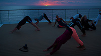 Yoga at Sunset on the Deck of the MV Explorer. Image taken with a Leica X2 camera  (ISO 100, 24 mm, f/3.5, 1/60 sec). Raw image processed with Capture One Pro, and Photoshop CC 2014.