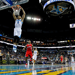 Mar 27, 2013; New Orleans, LA, USA; New Orleans Hornets shooting guard Eric Gordon (10) dunks against the Los Angeles Clippers during the second quarter of a game at the New Orleans Arena. Mandatory Credit: Derick E. Hingle-USA TODAY Sports