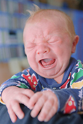 Portrait of newborn baby crying,