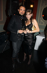 EVGENY LEBEDEV and CAROL SILLER at jeweller Stephen Webster's Christmas party held at Home House, 20 Portman Square, London W1 on 11th December 2006.<br />