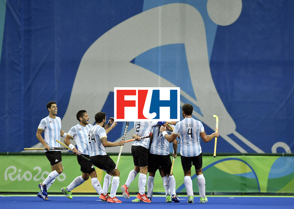 Argentina's Ignacio Ortiz (3rd R) celebrates after scoring a goal during the men's Gold medal field hockey Belgium vs Argentina match of the Rio 2016 Olympics Games at the Olympic Hockey Centre in Rio de Janeiro on August 18, 2016. / AFP / PHILIPPE LOPEZ        (Photo credit should read PHILIPPE LOPEZ/AFP/Getty Images)