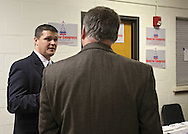 US House candidate Chris Reed speaks to a supporter at the 2010 Linn County Republican Caucus at Washington High School in Cedar Rapids on Saturday January 23, 2010. About 757 people attended the event. (Stephen Mally/Freelance)