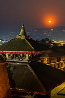 A high angle view over Durbar Square as a full moon rises, Bhaktapur, Kathmandu Valley, Nepal.