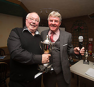 Eddie Ogg (president of the Belhaven Broughty Ferry Domino League) presents the Christmas Cup to John Brown of the Vault A -  Belhaven Broughty Ferry Domino League prizegiving at the Crown, Monifieth<br /> <br />  - &copy; David Young - www.davidyoungphoto.co.uk - email: davidyoungphoto@gmail.com