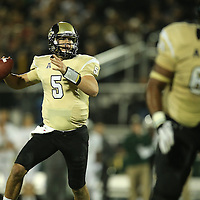 UCF Knights quarterback Blake Bortles (5) scrambles during an NCAA football game between the South Florida Bulls and the 17th ranked University of Central Florida Knights at Bright House Networks Stadium on Friday, November 29, 2013 in Orlando, Florida. (AP Photo/Alex Menendez)