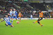 Hull City midfielder Sone Aluko (24) shoots at goal during the The FA Cup match between Hull City and Brighton and Hove Albion at the KC Stadium, Kingston upon Hull, England on 9 January 2016. Photo by Ian Lyall.
