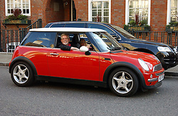 ROLF HARRIS arrives in his new mini  at Sir David & Lady Carina Frost's annual summer party held in Carlyle Square, London on 6th July 2004.
