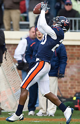 Virginia wide receiver Kevin Ogletree (20) catches a pass that led to a UVA touchdown that was called back on a penalty.  The Clemson Tigers defeated Virginia Cavaliers 13-3 in NCAA Division 1 football at Scott Stadium on the Grounds of the University of Virginia in Charlottesville, VA on November 22, 2008.