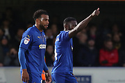 AFC Wimbledon defender Deji Oshilaja (4) and AFC Wimbledon midfielder Tom Soares (19) celebrating after goal during the EFL Sky Bet League 1 match between AFC Wimbledon and Southend United at the Cherry Red Records Stadium, Kingston, England on 24 November 2018.