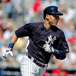 Mar 16, 2013; Tampa, FL, USA; New York Yankees shortstop Derek Jeter (2) hits a double against the Philadelphia Phillies during the bottom of the first inning of a spring training game at George Steinbrenner Field. Mandatory Credit: Derick E. Hingle-USA TODAY Sports