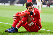 Swindon Town forward Keshi Anderson (10) sits on the pitch after being fouled during the EFL Sky Bet League 2 match between Milton Keynes Dons and Swindon Town at stadium:mk, Milton Keynes, England on 9 February 2019.